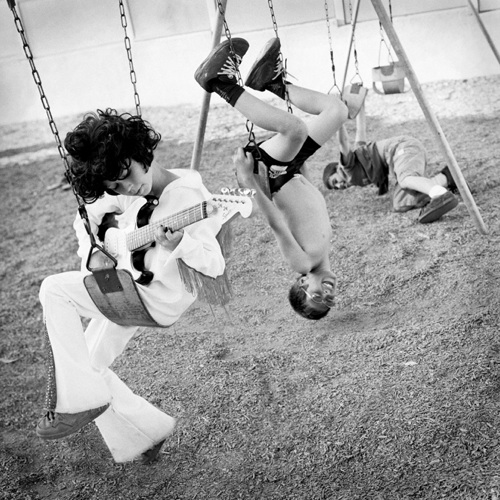 childrens photographer shoots fun picture of 3 boys on a swing