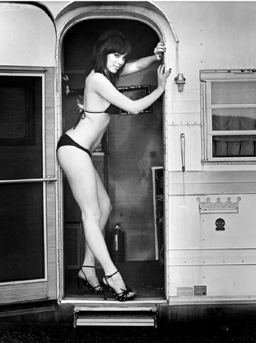 black & white photograph pinup model with a vintage airstream