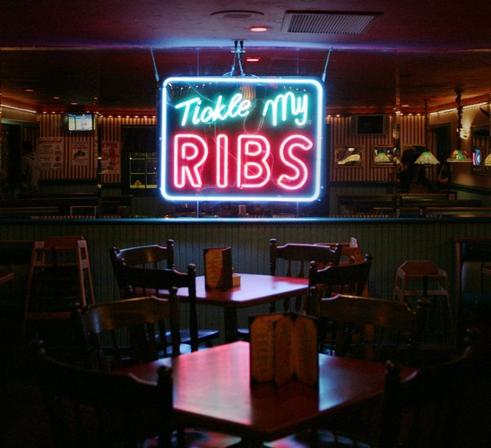 neon lights in diner recite a light hearted message for americana photographer heather hussey